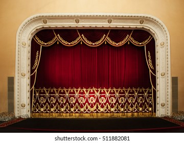 Open red curtains with glitter opera or theater background