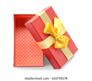 Open red gift box with golden ribbon on white background