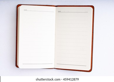 open red notepad isolated on white background