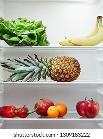 Open refrigerator containing fresh and healthy foods