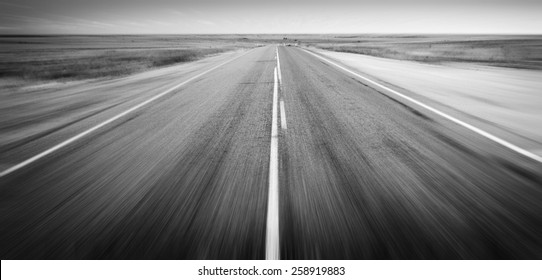 Open road ahead, endless road blur for concept in black and white