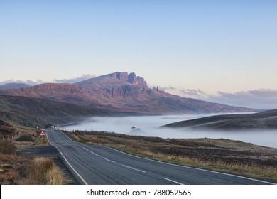 The open road on a misty autumn morning at The Storr, Isle of Skye, Scottish Highlands, Inner Hebrides, Scotland, UK