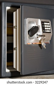 Open safe door with keys hanging on front