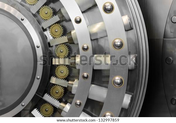 An open safe door in a vault