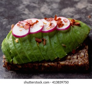 Open sandwich: avocado with raddish and chili flakes
