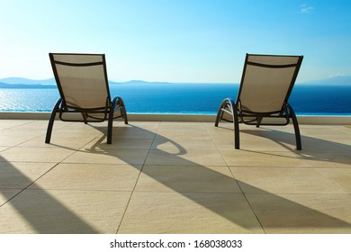 Open Sea with deck chairs - the perfect holiday scenery