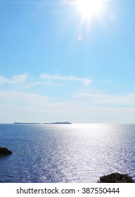 Open Sea with sun, sparkling water and cloudscape