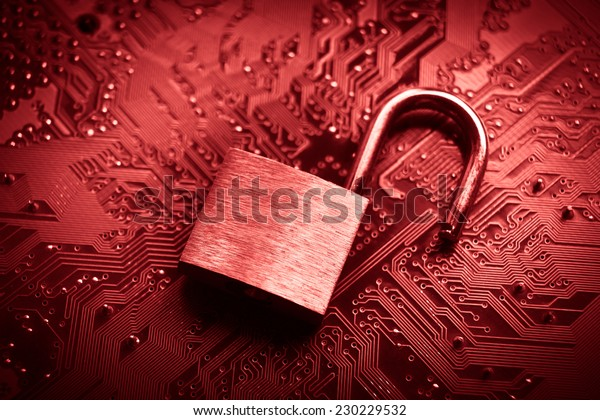 open security lock on computer circuit board - computer security breach concept