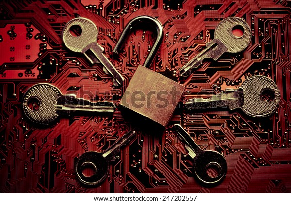 open security lock on a computer circuit board surrounded by keys / random password hacking attempt concept
