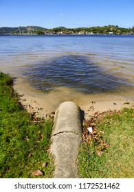 Open sewer going straight to Lagoa da Conceicao, famous lagoon and popular tourist destination in Florianopolis, Brazil