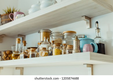 Open shelves with various food and spice ingredients