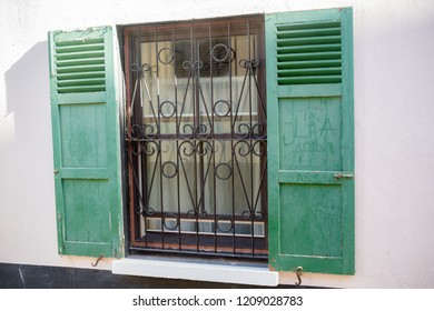Open shuttered windows in Gibraltar. Gibraltar is a British Overseas Territory located on the southern tip of Spain.