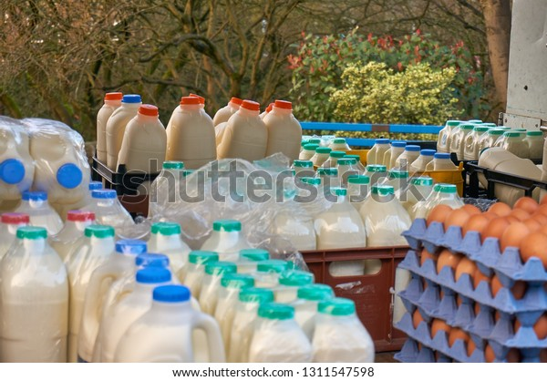 Open sided delivery vehicle carrying milk and eggs, close up - milk float on morning delivery round
