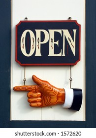 Open sign with pointing hand