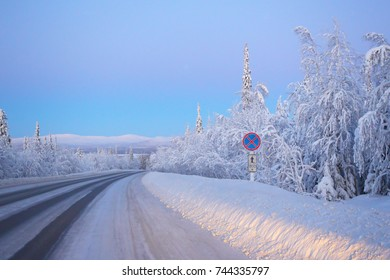 Open snow-covered road.Winter sunset.