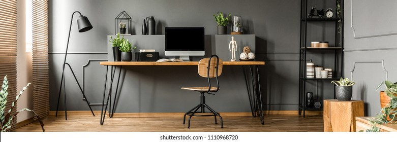 Open space living room interior with mockup computer, fresh plants and decoration placed on a home office desk