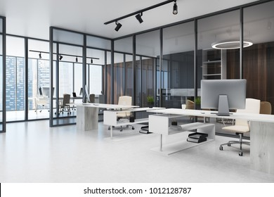 Open space office interior with a dark glass wall, a panoramic window and a concrete floor. Computer desks. 3d rendering mock up