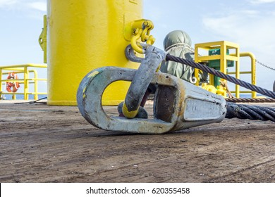 Open spelter sling socket for anchor buoy with shackle on deck of a construction barge at oilfield