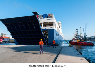 Open Stern Quarter Ramp Ferry and workers at Port of Mersin, Turkey.