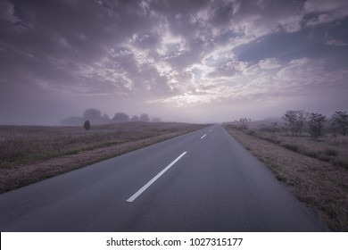 Open straight road in Deliblato Sands at foggy morning