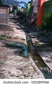 Open street Sewerage combined with running water drain, drainage structures, back streets, dirty street. Countries of South-East Asia. Unsanitary living conditions, poor sanitation