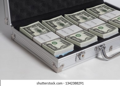 Open suitcase with one million dollars bills stacks