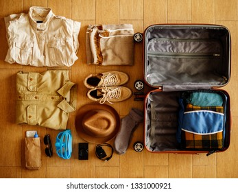 Open suitcase packed for travelling