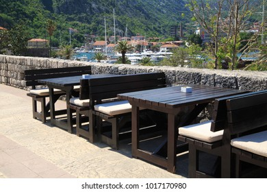 Open summer cafes in the background of mountains, Kotor, Montenegro.