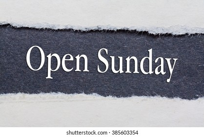 Open Sunday words under torn black paper.