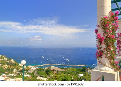 Open terrace with colorful flowers under the sun in Capri, Capri island, Italy