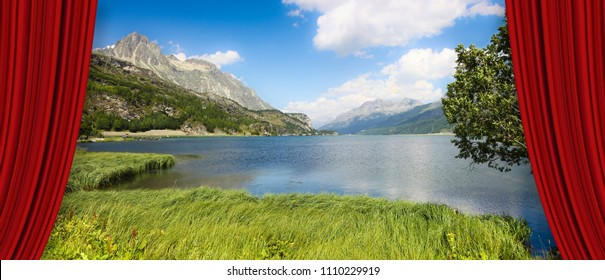 Open theater red curtains against Sils lake in the Upper Engadine Valley in a summer day (Europe -Switzerland) - concept image