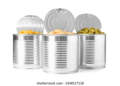 Open tin cans of peas, beans and corn kernels isolated on white