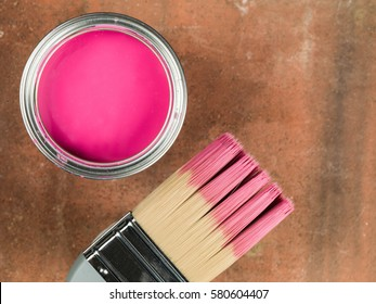 Open Tin of Pink Paint and a Paint Brush