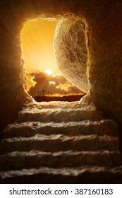 Open tomb of Jesus with sun appearing through entrance - Shallow depth of field on stone