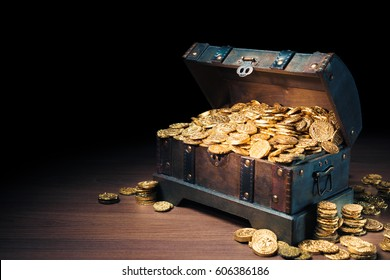 Open treasure chest filled with gold coins / HIgh contrast image