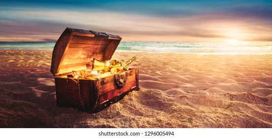 open treasure chest filled with golden items at sunset