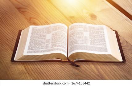 Open vintage christian bible on the desk