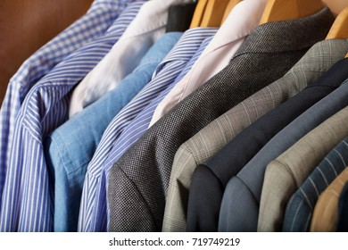 Open wardrobe of a business man. Closeup