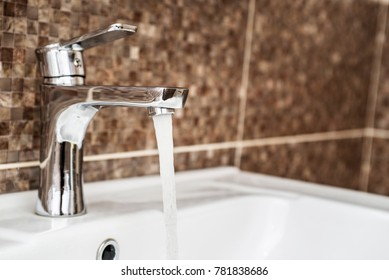 Open water tap with running water