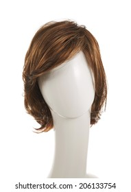 Open wave hair wig over the white plastic mannequin head isolated over the white background