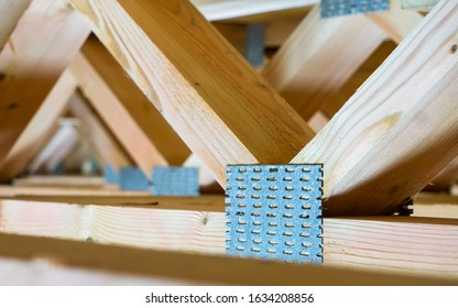 open web design wooden floor trusses closeup in framed construction made with steel connector plates