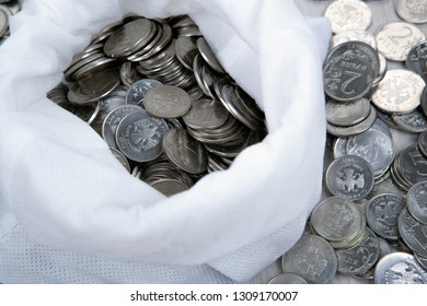 open white bag with russian ruble coins