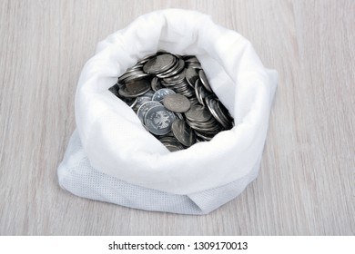 open white bag with russian ruble coins top view