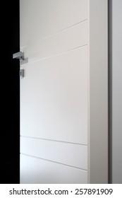 open white door on black background