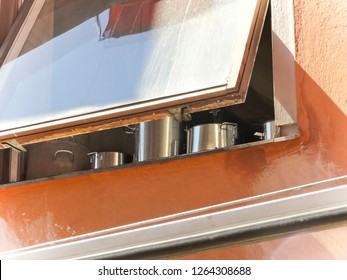 Open Window with Cooking Pots and Pans