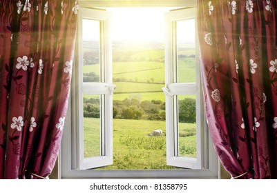 Open window with countryside view and sunlight streaming in