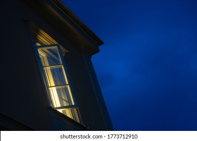 Open window at night with deep blue sky