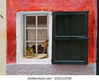 Open window in a red wall