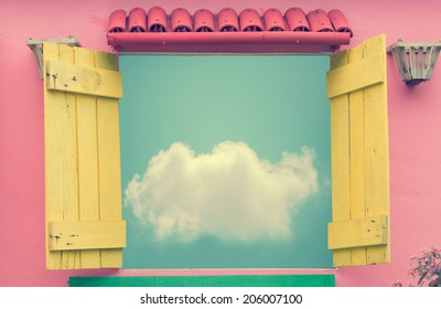 Open window in summer day with cloud on blue sky (vintage color toned image)
