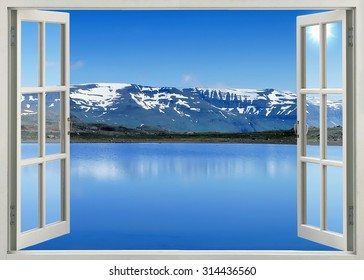 Open window view to mountain lake in Banff national park, Canada